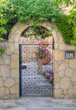 Beautiful traditional house  entrance with iron door, Nicosia, Cyprus. HDR processed shot of a beautiful traditional house entrance comprising an iron door in a Stock Photos