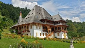 Beautiful traditional house in monastery courtyard. Maramures, Romania Royalty Free Stock Image