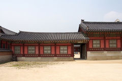 Beautiful traditional korean building elevation. Beautiful traditional red color korean building elevation with sand floor Stock Photo