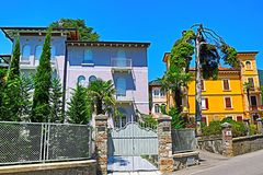 Beautiful traditional mansions on a street of Gardone Riviera Italy stock photos