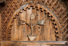 Beautiful traditional ornament in form of tulips from a hand made door from the entrance in a Romanian household Royalty Free Stock Photos