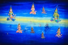 Beautiful traditional Thai style angels painting of folk literature on the ceiling at public Buddhist temple in Thailand. Beautiful traditional Thai style stock photo