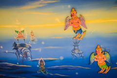 Beautiful traditional Thai style angels painting of folk literature on the ceiling at public Buddhist temple in Thailand. Beautiful traditional Thai style stock image