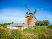 Beautiful and traditional thatched windmill in german north sea Stock Image