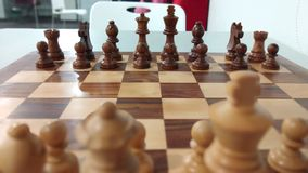 Wooden chess piece on chess board ready to play. stock photography