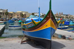 Beautiful tradiyional fishing boat in Marsaxlokk South of Malta. Beautiful scene of a traditional fishing boat in Marsaxlokk South of Malta Stock Photo