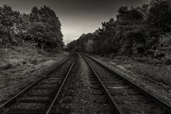 Train tracks in mono. The beautiful train tracks in suffolk, england stock images