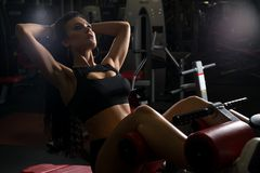Beautiful trainer exercising on a simulator in gym royalty free stock images