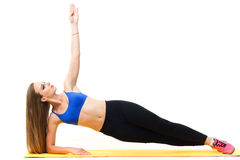 Beautiful trainer working out with yoga mat  on white Royalty Free Stock Image