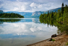 Beautiful tranquil landscape with mountains and reflection of cl