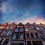 Beautiful tranquil scene of Amsterdam. Starry sky above beautifu Stock Photos
