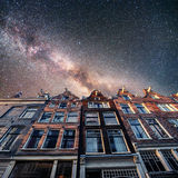 Beautiful tranquil scene of Amsterdam. Starry sky above beautifu Royalty Free Stock Images