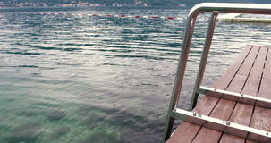 Beautiful tranquil summer scenery – Sea, wooden jetty and sea ladder – Summer stock video