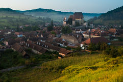Beautiful Transylvanian saxon village and fortified church in morning sunlight Stock Image