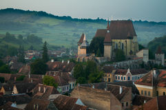 Beautiful Transylvanian saxon village and fortified church in morning sunlight Stock Photography