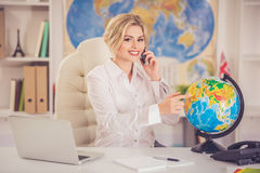 Beautiful travel agent Stock Images