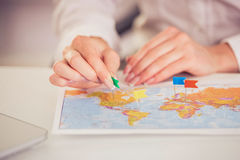 Beautiful travel agent. Travel or tourist concept - map and destination signs on it. Close-up Royalty Free Stock Photo