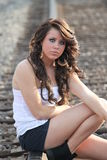 Beautiful Traveler. Lovely young lady on the railroad track Royalty Free Stock Photography