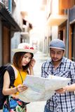 Beautiful traveler or backpacker young woman is confusing the wa royalty free stock photo