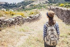 Beautiful traveler girl on a hiking trail, travel and active lifestyle concept stock images