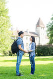 Beautiful traveling couple holding hands in summer park Royalty Free Stock Image