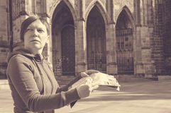 Beautiful traveling woman reading a map Stock Image
