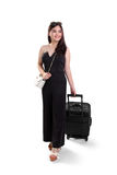 Beautiful traveling woman with suitcase, full body shot Stock Photography