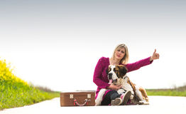 Beautiful traveller girl. Girl with a dog hitchhike Stock Photography