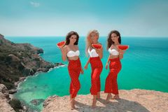 Beautiful traveller girl friends having fun in swimwear outfit h Stock Images