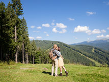 Beautiful travelling couple in love making selfie. Over mountain panorama Stock Images