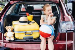 Free Beautiful Travelling Girl Sitting In Car Trunk Royalty Free Stock Image - 118813646