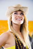Beautiful trendy blond in a stylish straw hat Stock Image