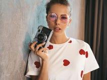 Beautiful trendy girl posing in studio stock photos