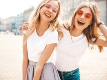 Beautiful Trendy Girls Posing In The Street Royalty Free Stock Images