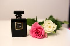 Beautiful and Trendy Perfume Sprayer on a White Table with Two Roses. March 2017, Espoo, Finland: Beautiful still life photo made with a luxurious classic Coco stock images