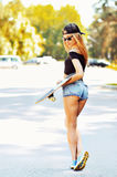 Beautiful trendy skater woman, outdoor full length portrait Stock Photo