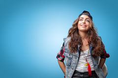 Beautiful trendy stylish hipster girl in cap smiling Stock Photography