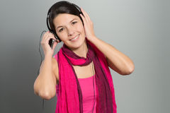 Beautiful trendy woman listening to music Royalty Free Stock Images