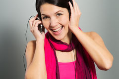 Beautiful trendy woman listening to music Royalty Free Stock Image