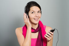 Beautiful trendy woman listening to music Stock Image