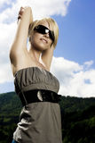 Beautiful trendy woman in modern sunglasses Stock Photo