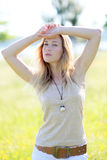 Beautiful trendy woman standing in meadow Royalty Free Stock Photos