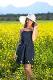 Beautiful trendy woman in a summer sunhat. Stock Photo