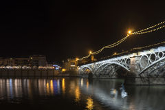 Beautiful Triana bridge next to the Guadalquivir river on its way through the city of Seville, Andalusia. Views of the most famous bridges in the city of Seville stock image
