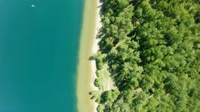 Beautiful tropical beach aerial. Bird`s eye view of coastline. Cyan ocean, trees. Beautiful tropical beach aerial - a bird`s eye view of coastline. Cyan ocean stock video