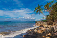 Beautiful tropical beach with black sand. Summer vacation concep Royalty Free Stock Photos