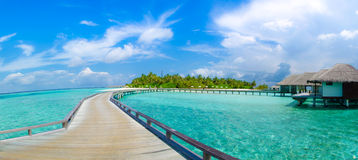 Beautiful tropical beach with bungalos panorama view at Maldives Royalty Free Stock Images