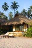Beautiful tropical beach bungalow Stock Images