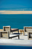 Beautiful tropical beach with chairs and swimingpool Royalty Free Stock Images