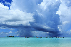 Beautiful tropical beach with cumulus storm cloud and pouring ra Royalty Free Stock Photo
